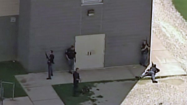 Police work to secure Perry Hall High School after a shooting was reported early Monday morning. (Source: WJZ/CNN)
