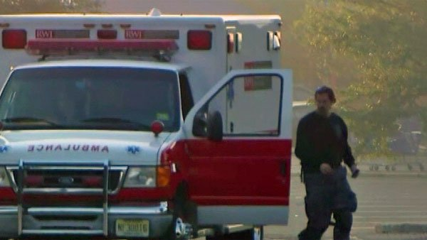 An emergency responder gets out of his truck by the Pathmark supermarket where three were killed Friday in Old Bridge, NJ. (Source: WABC/CNN)