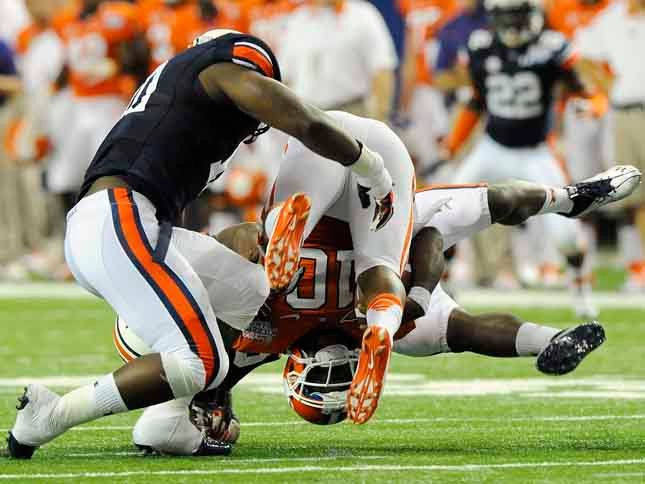 © Clemson quarterback Tajh Boyd is tackled by Auburn's LaDarius Owens, left, and Dee Ford in the first half. Auburn vs Clemson on Saturday, Sept.1, 2012 in Atlanta, GA. (Source: Todd Van