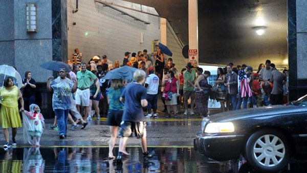 Showers at a James Taylor concert ahead of the Democratic National Convention sent people running for cover under awnings, hotel drive ups, parking garages and covered restaurant patios.(Source: Cecelia Hanley/RNN)