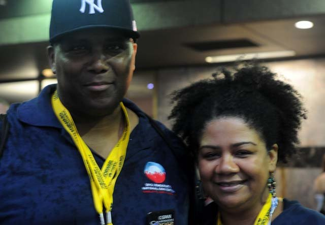 Arlene McCray and her boyfriend, Lewis Lindo, are spending the week volunteering with the convention. (Source: Cecelia Hanley/RNN)