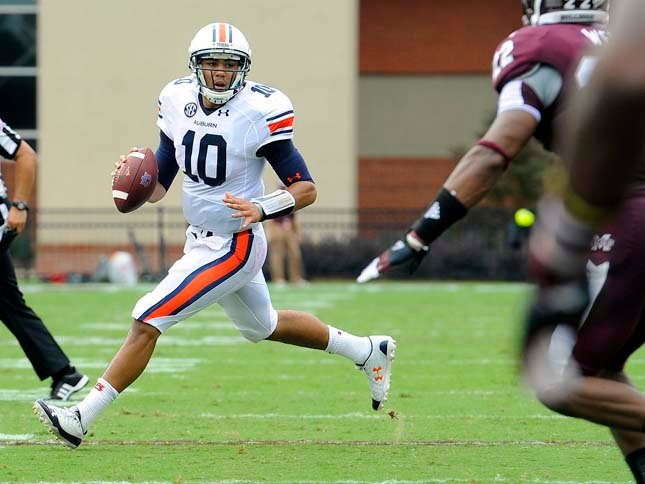 Auburn quarterback Kiehl Frazier avoids the rush in the first half against Mississippi State. (Source: Todd Van Emst/Auburn University)