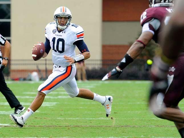 Auburn quarterback Kiehl Frazier avoids the rush in the first half against Mississippi State. (Source: Todd Van Emst/Auburn University)
