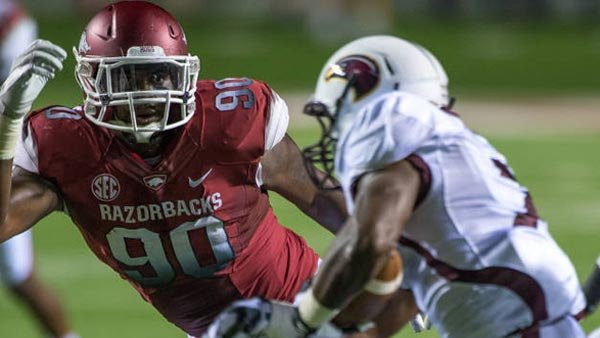 Colton Miles-Nash bears down on a Louisiana Monroe running back in last week's upset loss to the Warhawks in Little Rock, AR. (Source: Walt Beazley, Arkansasrazorbacks.com)