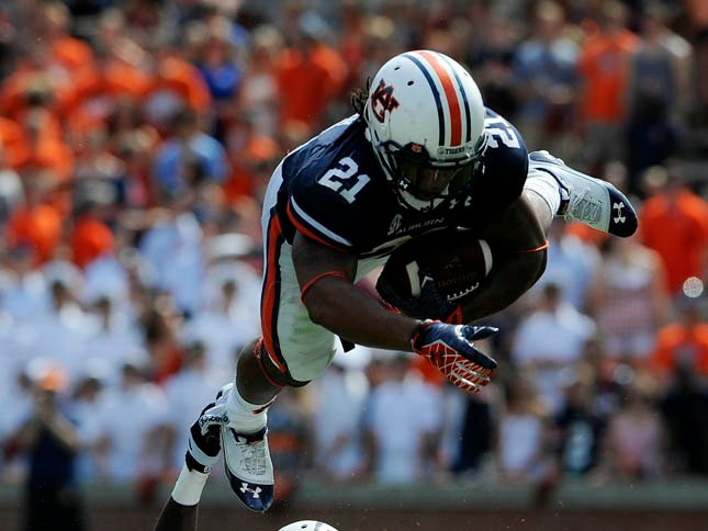 © Auburn's Tre Mason gets tripped up during a run against Louisiana-Monroe on Sept. 15. (Source: Todd Va