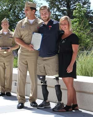Rear Adm. Frank A. Morneau presented Taylor Morris with the Bronze Star medal in August. Taylor is joined by his girlfriend, Danielle Kelly. (Source: Flickr/Official U.S. Navy Imagery/Patty Babb)