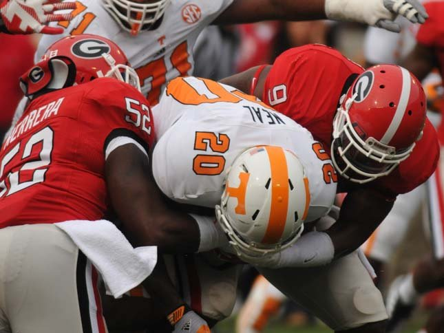 Linebacker Amarlo Herrera (52) and linebacker Alec Ogletree (9) make a tackle during the Bulldogs' game against Tennessee on Saturday, Sept. 29, 2012. (Source: Georgia Athletics)