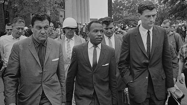 James Meredith walking to class with U.S. Marshals on Oct. 1, 1962. (Source: The Library of Congress)