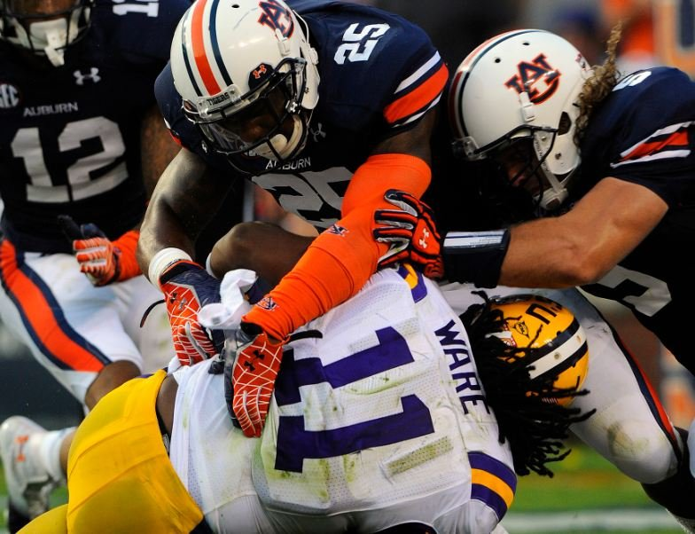 Auburn's defense played well against LSU in its last outing, but will be tested by Arkansas' Tyler Wilson (Source: Todd Van
