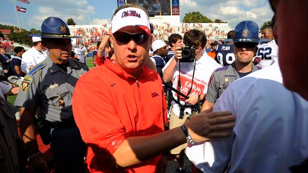 Ole Miss coach Hugh Freeze shakes hands with Auburn's Gene Chizik after the Rebels picked up their first SEC win of the year. (Source: Todd Van Emst/Auburn University)