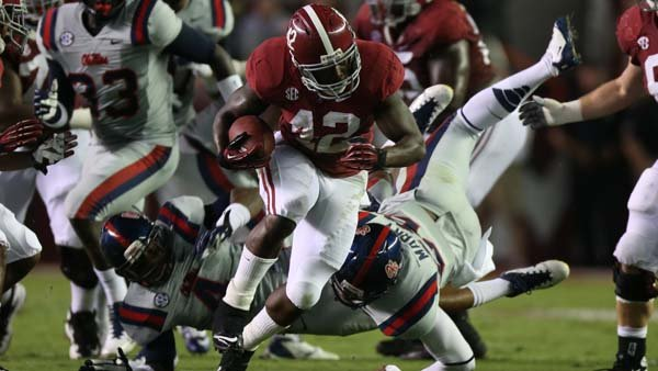 Alabama running back Eddie Lacy (42) runs against Ole Miss. Lacy had a career-high 177 yards last week against M