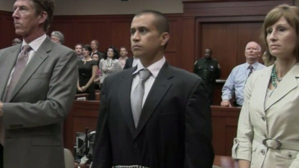 George Zimmerman, center, stands with his attorneys at a preliminary hearing in Sanford, FL, Wednesday. He is charged with second-degree murder in the killing of Trayvon Martin. (Source: Central Florida News 13/CNN)