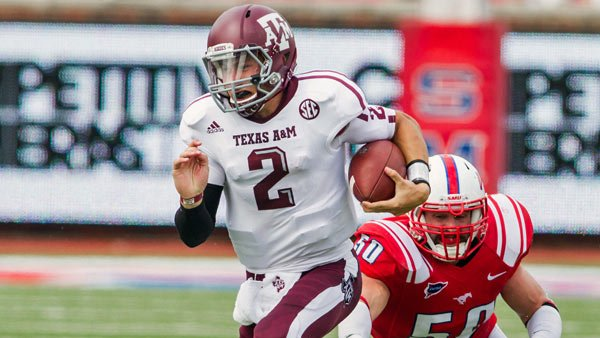 Johnny Manziel has been leaving defenses in his dust this season.  (Source: Texas A&M Athletics)