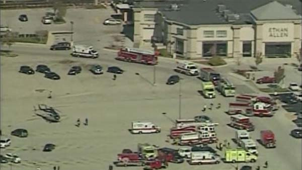 Police and rescue crews were on the scene of a shooting at a spa near a mall in Brookfield, WI, on Oct. 21. A small fire was also reported in the building, according to police. (Source: WTMJ/CNN)