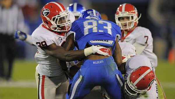 Georgia defenders are depicted tackling a player from Kentucky, which wears uniforms similar to Florida's. Don't expect to see this level of domination against Florida. (Source: John Kelley))