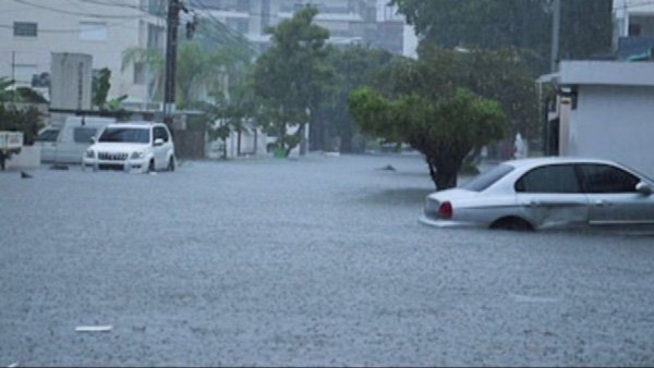 Hurricane Sandy caused severe flooding in the Dominican Republic and other parts of the Caribbean. At least 43 people are dead as a result of the storm. (Source: Misael Rincon/CNN iReport)