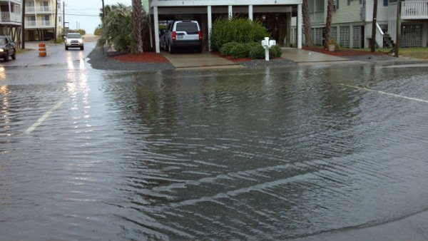 Streets in Carolina Beach, NC, already saw flooding attributed to Hurricane Sandy on Saturday. (Source: WECT)