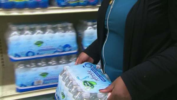 Residents in Washington empty store shelves of water and other supplies in advance of Hurricane Sandy. (Source: CNN)