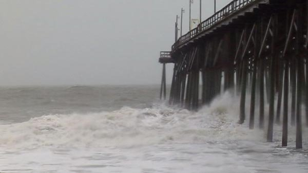 Hurricane Sandy churns out in the Atlantic Ocean, worrying forecasters about the possible storm surge. (Source: WECT)