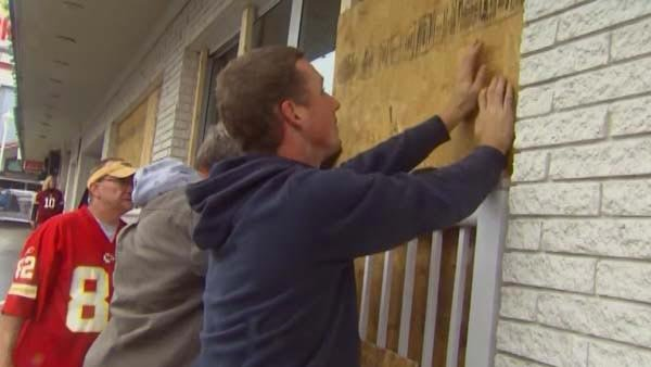 Residents of Ocean City, MD, boarded up homes and businesses in preparation of Hurricane Sandy on Sunday. (Source: CNN)