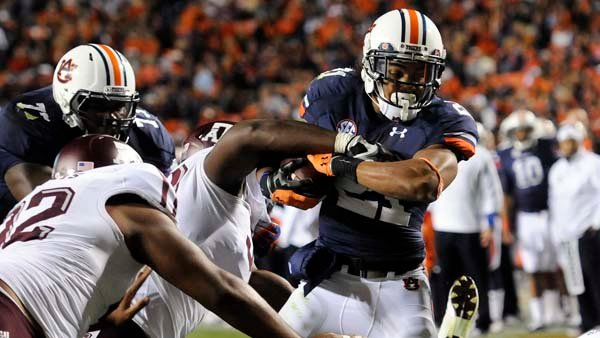 Auburn's Tre Mason (21) scores a touchdown against Texas A&amp;M. The score was in honor of Marcus Lattimore, but Auburn needed seven more to avoid a losing season. (Source: Todd Van Emst/Auburn University)