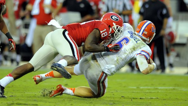 Georgia safety Bacarri Rambo tackles Florida quarterback Jeff Driskel. (Source: Georgia Athletics)