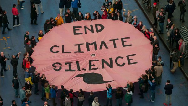 Supporters of 350.org protested 'climate silence' in Times Square days before Superstorm Sandy hit New York City. (Source: 350.org)