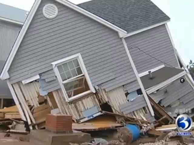 Houses were toppling over after Hurricane Sandy swept through East Haven, CT. (Source: WFSB)