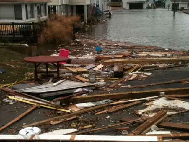 Debris and flooded streets filled a street in East Haven, CT after Sandy came through. (Source: WFSB)