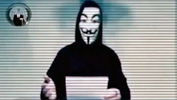 "Hacktivist group Anonymous posted a video on YouTube in December 2011 with a ""warning to the American people."" (Source: YouTube/anonymous04210)"