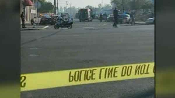 Shown is the scene after a shooting injured killed three and injured two others at a plant in Fresno, CA. (Source: CNN)