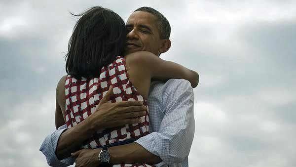 "Barack Obama's official Twitter account sent out the photo of him embracing his wife, Michelle, along with the phrase ""four more years."" (Source: @BarackObama)"