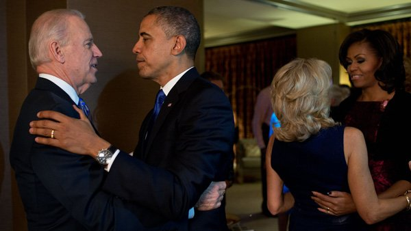 President Barack Obama and Vice President Joe Biden hug after learning of their victory in the 2012 election. (Source: White House)