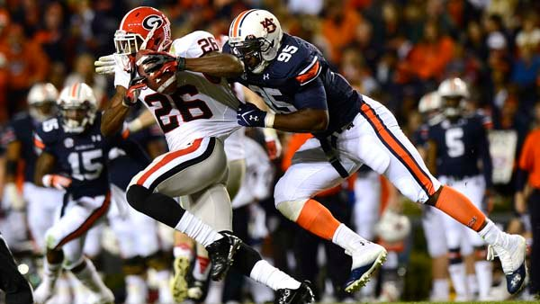 Georgia's Malcolm Mitchell picks up yards on his way to helping Georgia pick up an SEC championship game berth. (Source: Todd Van Emst/Auburn University)