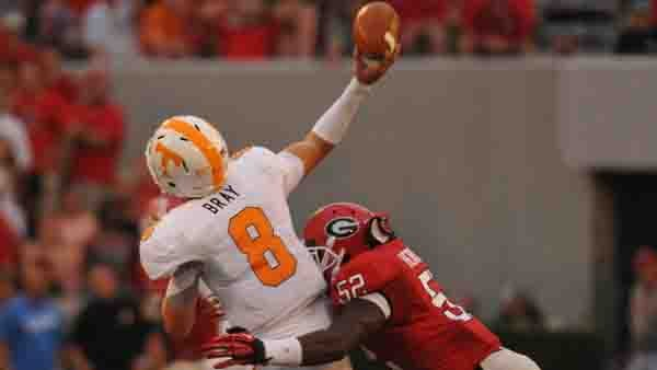 Tennessee's Tyler Bray gets hit as he throws against Georgia earlier in the season. Most of Bray's passes end better than this one. (Source: Georgia Athletics)
