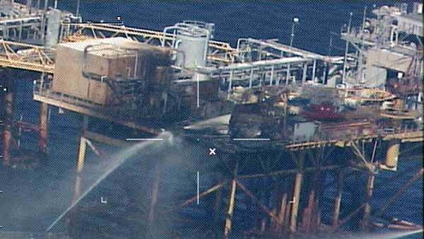 Vessels pour water on the platform where an oil rig exploded. (Source: U.S. Coast Guard)