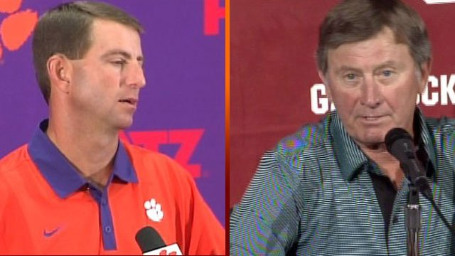 Dabo Swinney (L) of Clemson and Steve Spurrier of South Carolina are known for their verbal feuds. Will the two meet again in a postseason bowl? (Source: WHNS)