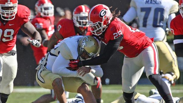 Jarvis Jones, shown clobbering a Georgia Tech runner, is the hub of the Georgia defense. (Source: Wes Blankenship)