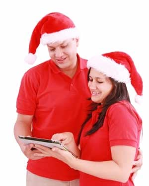 Enjoy Christmas apps alone or with loved ones. (Source: David Castillo Dominici/FreeDigitalPhotos.net)