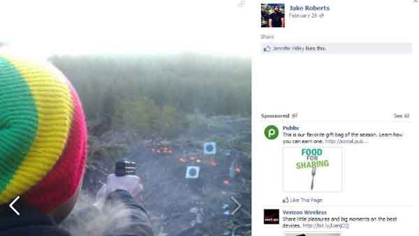 A photo taken from Jacob Tyler Roberts Facebook page shows an unidentified man shooting a gun. (Source: Facebook)