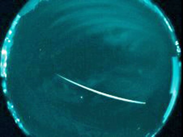 A Geminid meteor as seen in a 2011 false-color image captured by NASA. (Source: NASA)