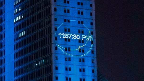 The countdown to the new year is projected on the RSA BankTrust building. (Source: Tad Denson/myshots.com)