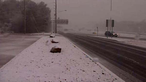 Snow is falling across Shreveport, LA after severe storms blasted through the area earlier in the day. (Source: KSLA)