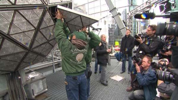 Workers install panels engraved with Dick Clark's name on the Times Square ball. (Source: CNN)