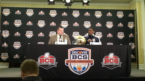 Notre Dame offensive coordinator Chuck Martin, left, and quarterback Everett Golson, meet with members of the media Friday. The Fighting Irish take on Alabama in the BCS National Championship on Monday. (Source: Tom Ensey/RNN)
