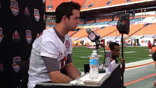 Alabama quarterback A.J. McCarron talks with reporters on the field. (Source: RNN/Tom Ensey)