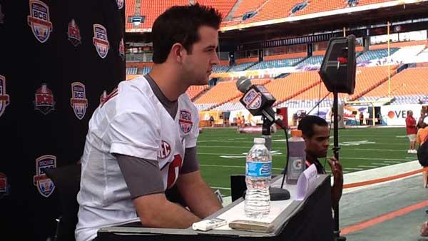 Alabama quarterback A.J. McCarron talks with reporters on the field. (Source: RNN/Tom Ensey)