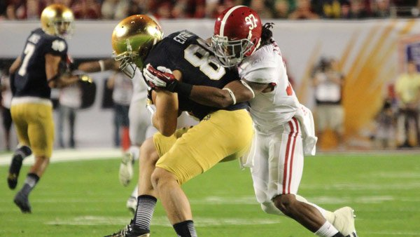 Alabama's Robert Lester stops Notre Dame's Tyler Eifert during a play in the second quarter of the BCS National Championship game in Miami, FL. (Source: Dennis Washington/WBRC)