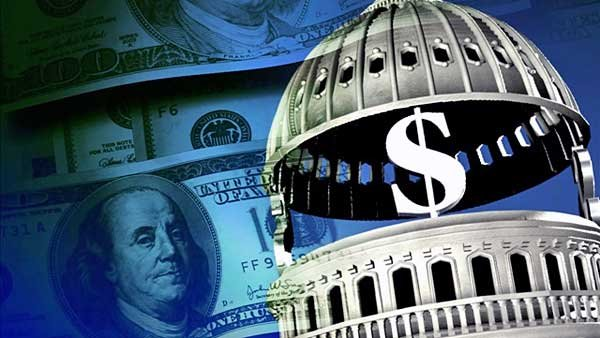The U.S. Treasury technically can – and should, according to some – print a single coin that can wipe out the balance of the country's $1 trillion debt. (Source: MGN)
