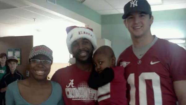 Little Starla Chapman and family meets Alabama Quarterback AJ McCarron. (Source: YOUTUBE)